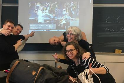 Fulbright Finland Inter-Country Travel Grantee Loralie Heagy with a group of music teacher making funny faces in a class room