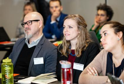 U.S. Fulbrighters Matthew Freedman, Michelle Paterick and Julia Miller concentrating on a presentation during Truth Matters seminar in Helsinki