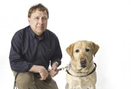 Poet, disability advocate and Fulbright alumnus Stephen Kuusisto with his guide dog, a labrador retriever.