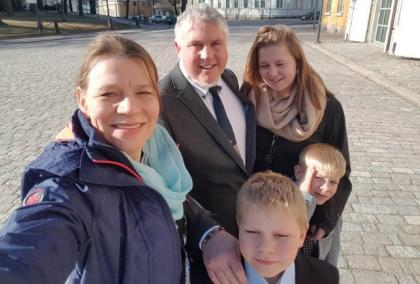 Bickford family selfie. Fulbright Specialists Sonja and Nate Bickford with their three children smiling at the camera.