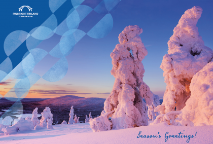"A wintery view, taken in Lapland, Finland. There is a lot of snow on trees, and a fell can be seen in the background. Sun is shining from low, coloring the photo in reds and yellows. There is a Fulbright Finland Foundation logo on the right and it says ""Season's Greetings!"" on the bottom."