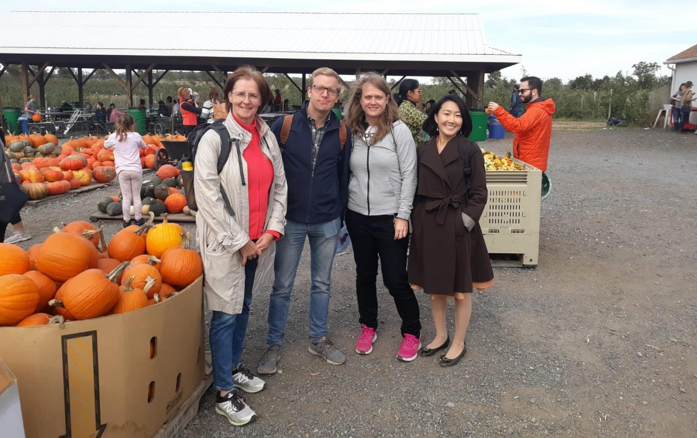 Photo of four scholars in a pumkin field, for MCPD grantee blog