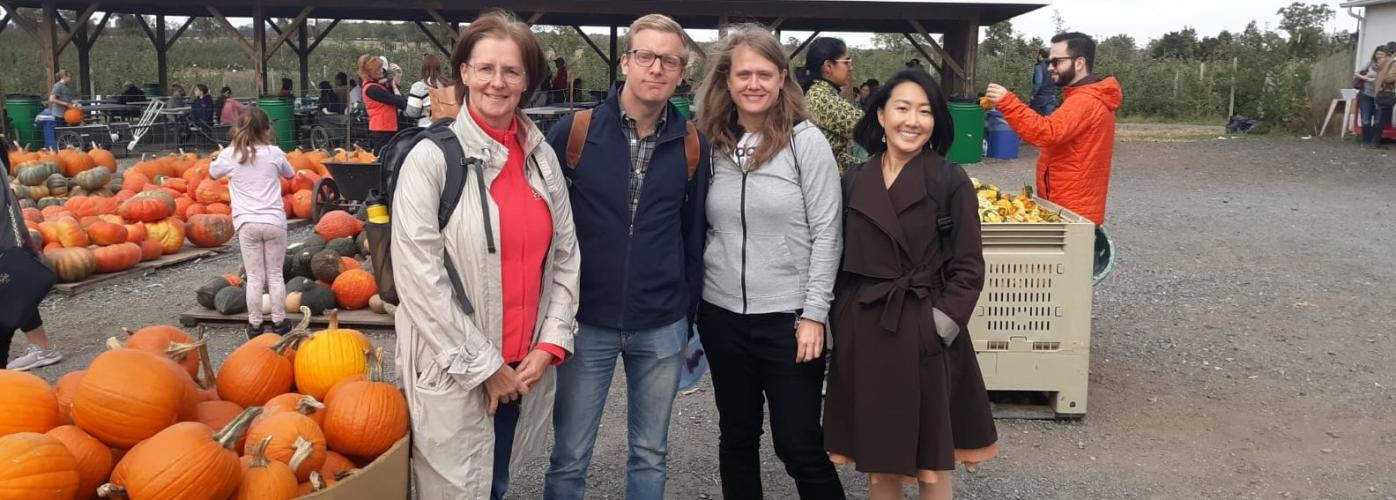 MCPD grantee Aulikki Pakanen and other visiting scholars at a pumpkin field