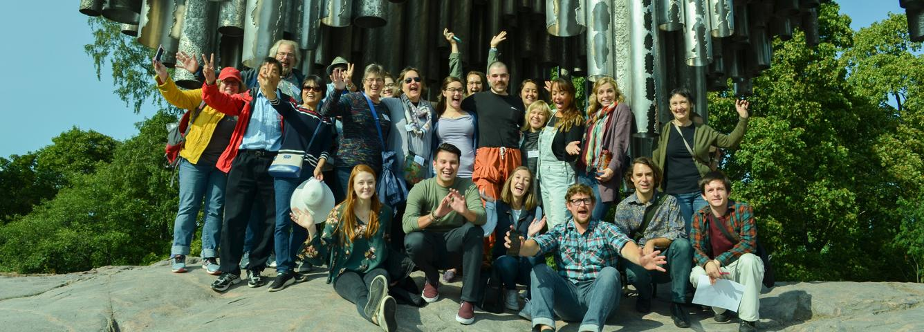 2018-2019 U.S. Fulbrighters waving at the Sibelius Monument in Helsinki