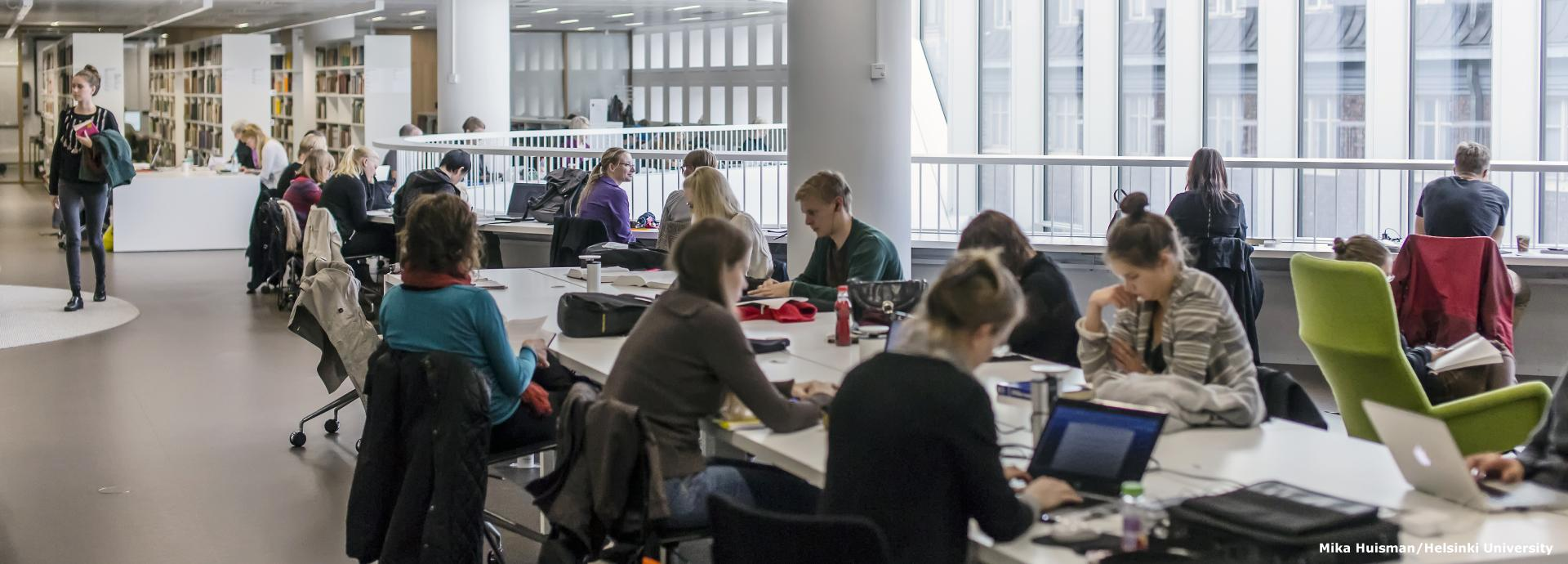 Students studying in the Helsinki University Main Library
