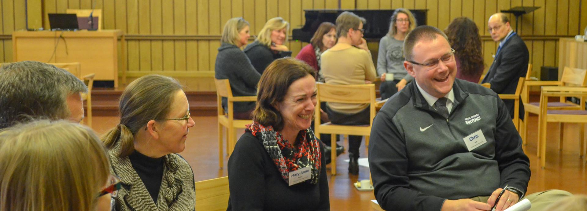 Two Fulbright Leaders for Global Schools participants laughing during a small group discussion in the Seminarium Festival hall at the University of Jyväskylä
