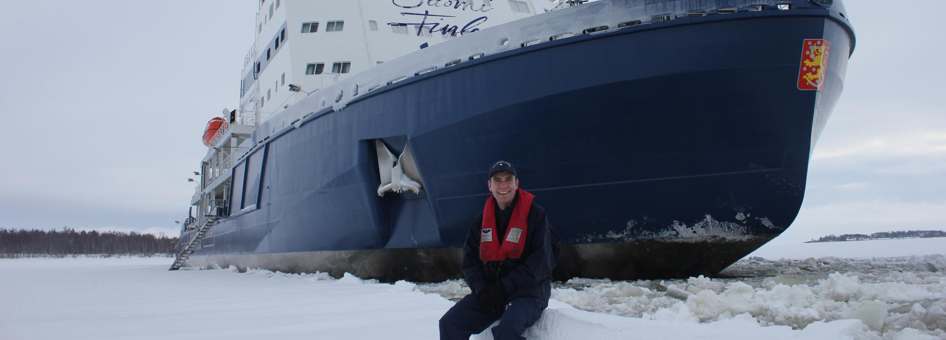 Fulbright Finland Mid-Career Professional Development program participant in front of a Finnish icebreaker.