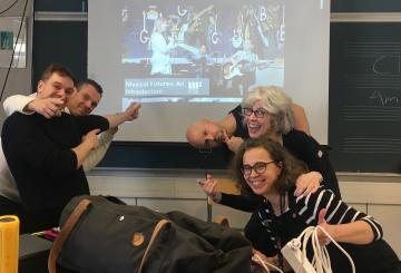 Inter-Country grantee Lorrie Heagy on her visit to Finland with new colleagues laughing after a workshop